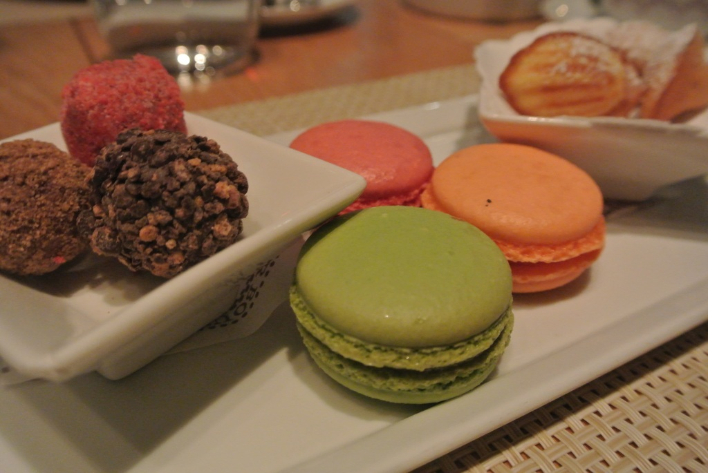 Petit fours - bonbons, macarons and madeleines.