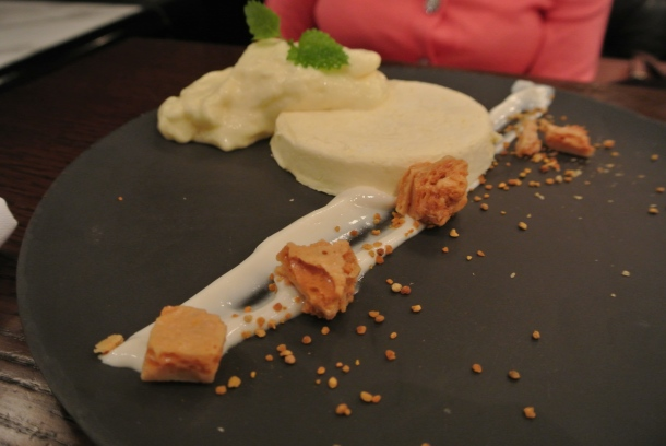 Dessert - Panna Cotta with broken pieces of brittle.