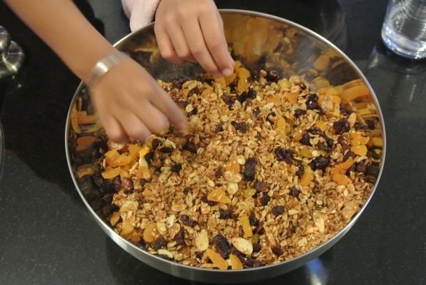 Finished granola with dried apricots, raisins, slivered almonds and sunflower seeds.