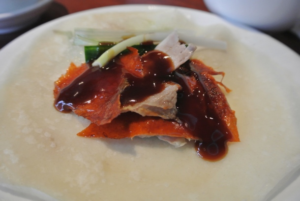 How to eat Peking duck skin, you wrap it up and eat similar to a taco - delicious!