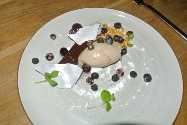 My dessert - chocolate bar with caramalized peanuts, blueberries, hazelnut and banana sorbet.
