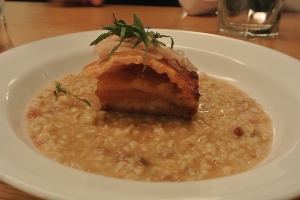 Another appetizer - pork belly with really crispy skin on a bed of oats.