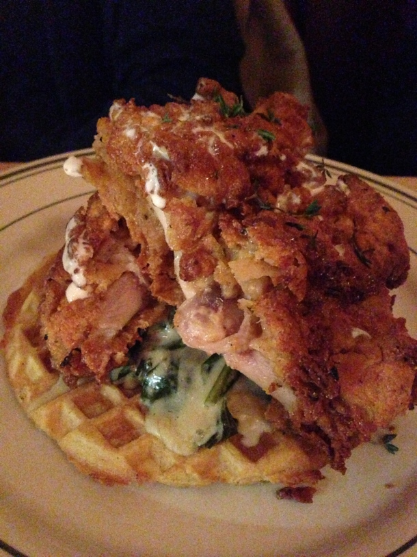 Gabardine's take on fried chicken on a cornmeal waffle with creamed collard greens and maple syrup.