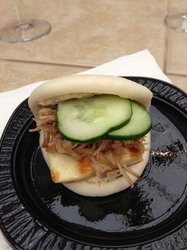 Momofuku's steamed bun filled with pulled pork, grilled guernsey girl cheese and cucumbers.  YUM!