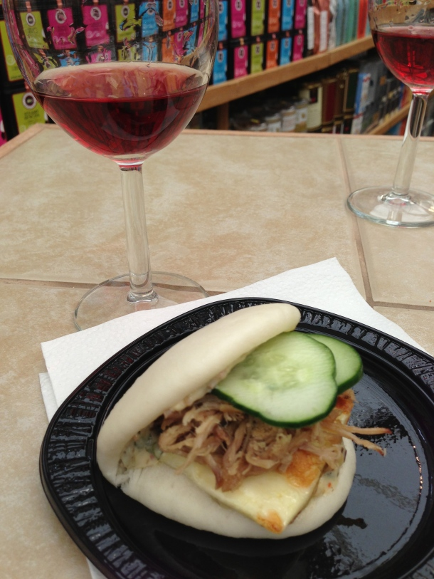 Enjoying my steamed bun with a glass of rose from Hidden Bench Wineries.