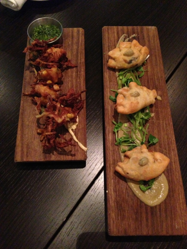 Appetizers: left - corn and scallop pakoras, right - spinach and black bean empanadas.