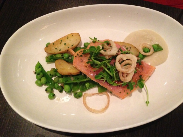 Rainbow trout with onion soubise, potatoes and peas.