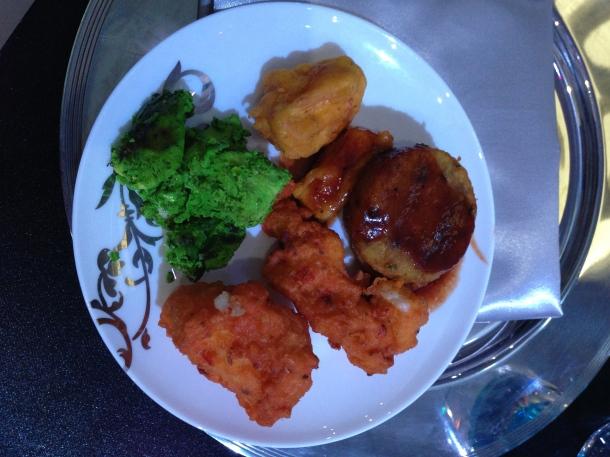 My appetizer buffet plate - fish pakoras, chicken, potato patties.