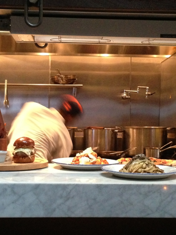 Open kitchen of Gusto 101 - watching plates being expedited.