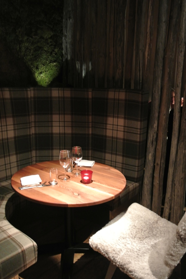 "Our table - feels very ""Canadian"" with the plaid and wood table."