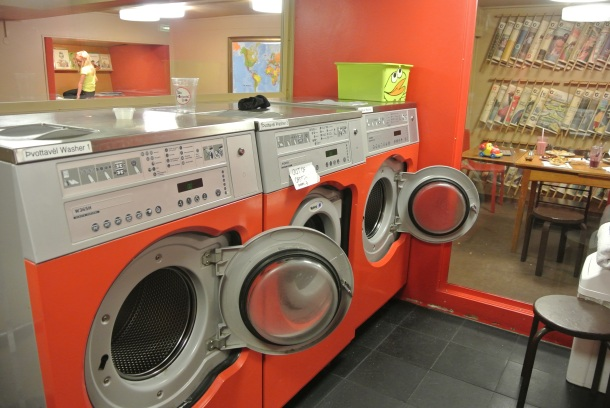 Laundry machines available in the basement of the cafe.