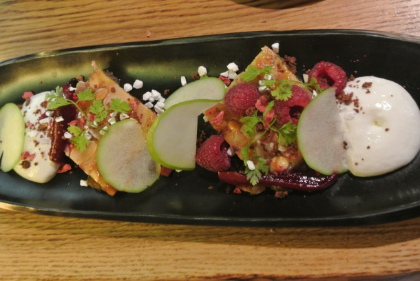 Apple cake with foamy buttermilk, pears, beet root syrup and white chocolate.