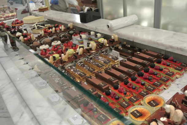 An entire row of beautiful pastries so perfectly laid out.