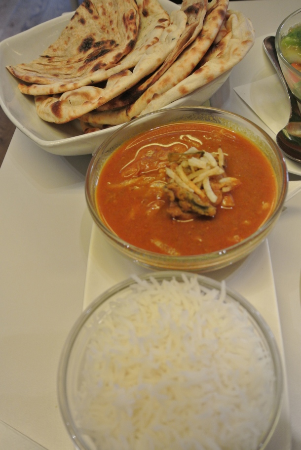 Pulusu Chicken - chicken curry with steamed rice and naan.