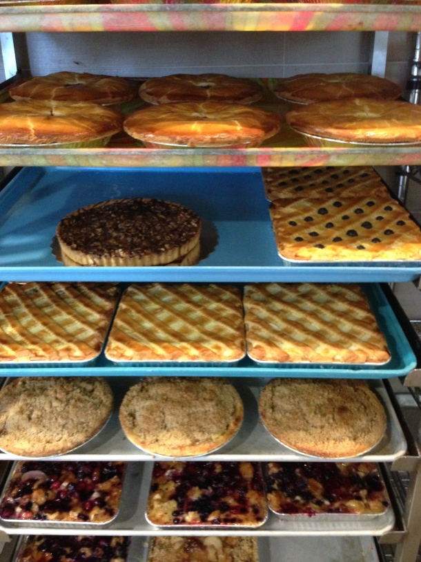 Shelves of pies and cheesecakes.
