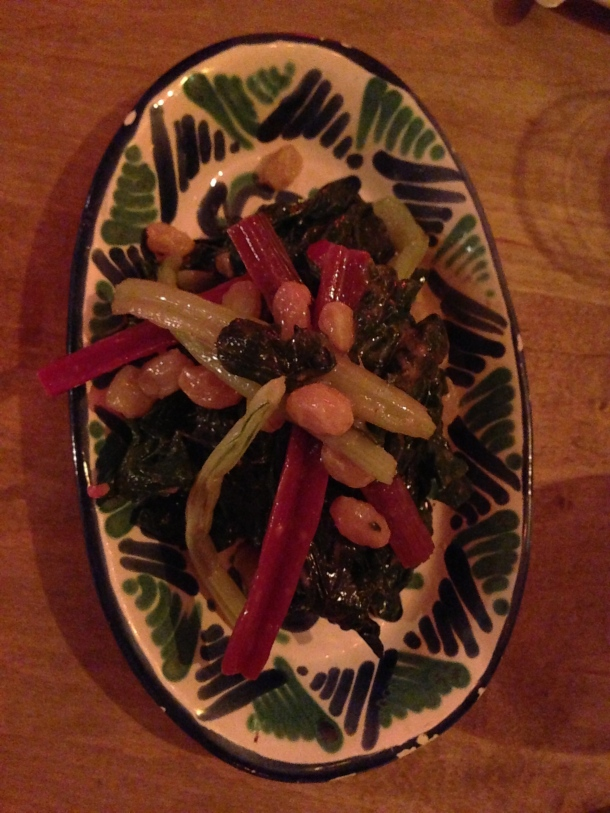 Marinated swiss chard with raisins and anchovies.