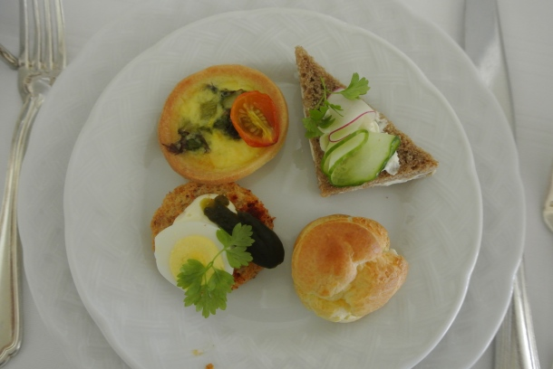 Deliciou savoury plate: asparagus and tomato tart, quail egg on a crouton, chicken and apple gougier, and cucumber on pumpernickel.