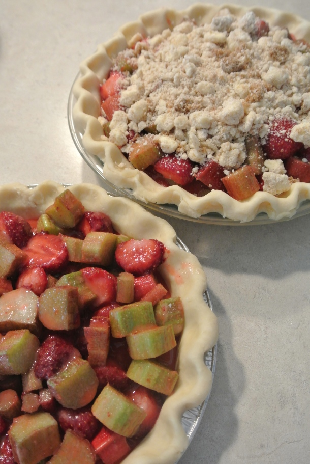 Strawberry rhubarb pie filled and then topped with a sweet crumble topping before going into the oven.