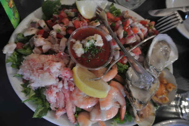 The cold combo platter - crab meat, ceviche, oysters, clams and peel and eat shrimp.