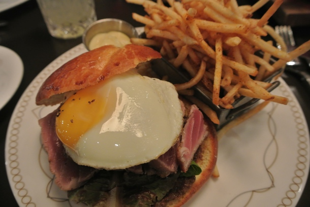 My seared tuna steak sandwich with tomato, fried egg on a house-baked brioche bun.