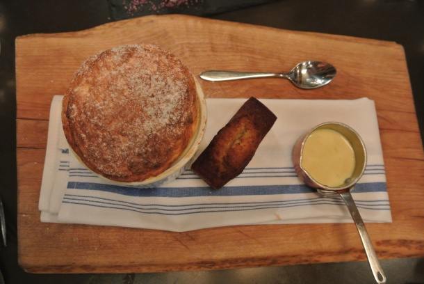 Delicious passion fruit souffle with a pistachio financier and creme anglaise.