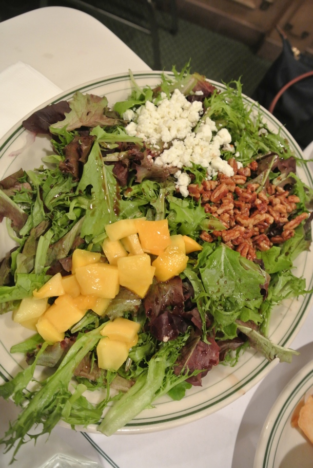The Versailles salad with fresh mango, candied pecans and goat cheese.