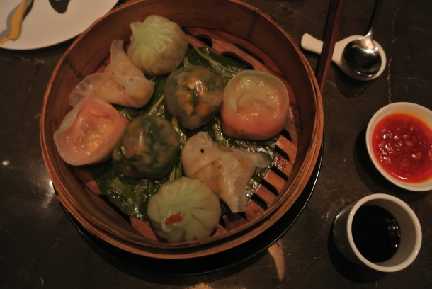 A platter full of vegetarian steamed dumplings.