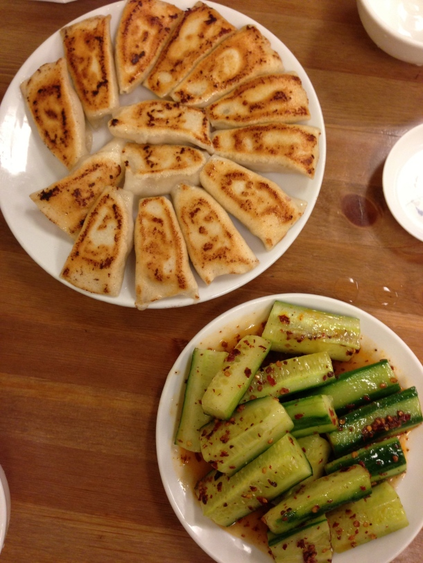 Pork and Chive pan fried dumplings and Cucumber with flavour.