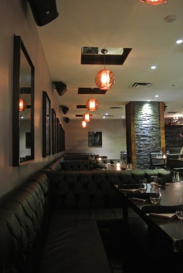 Inside &Co - view of the restaurant and bottle service area.
