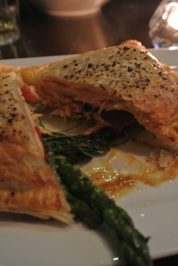 A closer look at the salmon baked inside the puffed pastry.