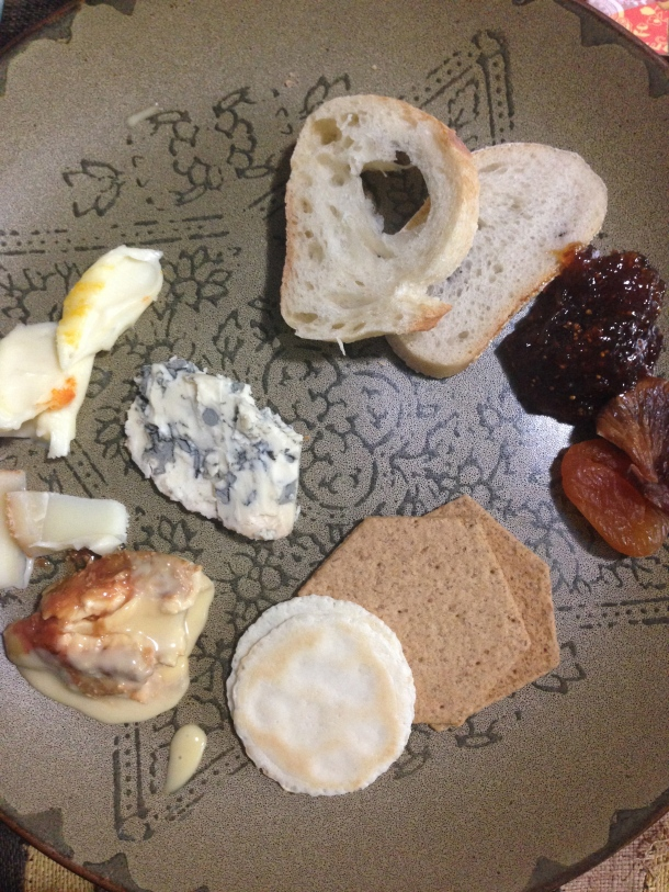 My full plate of cheese, baguette, crackers and fig preserves.