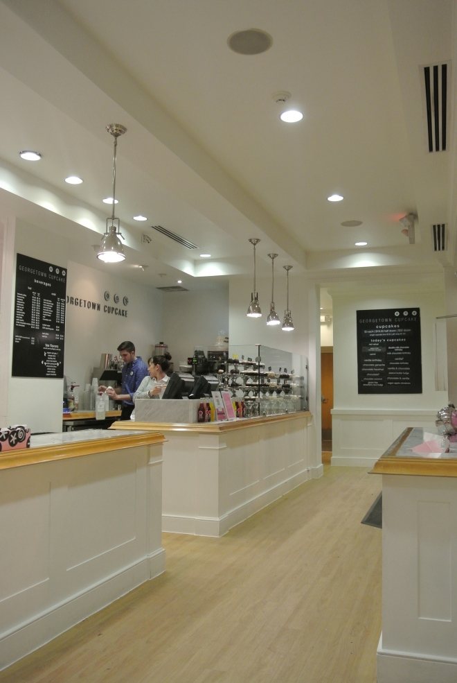 The very white and clean interior of Georgetown Cupcake.