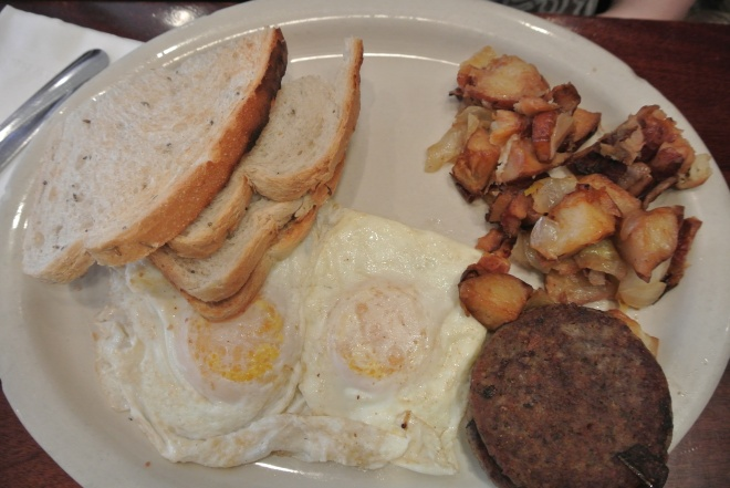 The classic Village Breakfast Special, 2 eggs overeasy, sausage patties, rye toast and hash browns.