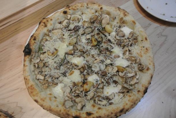 Cremini mushroom pizza with roasted garlic, buffalo mozzarella, gorgonzola, rosemary, thyme and pecorino.