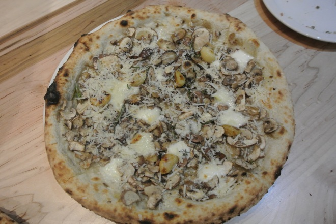 Cremini mushroom pizza with roasted garlic, buffalo mozzarella, gorgonzola, rosemary, thyme and pecorino.