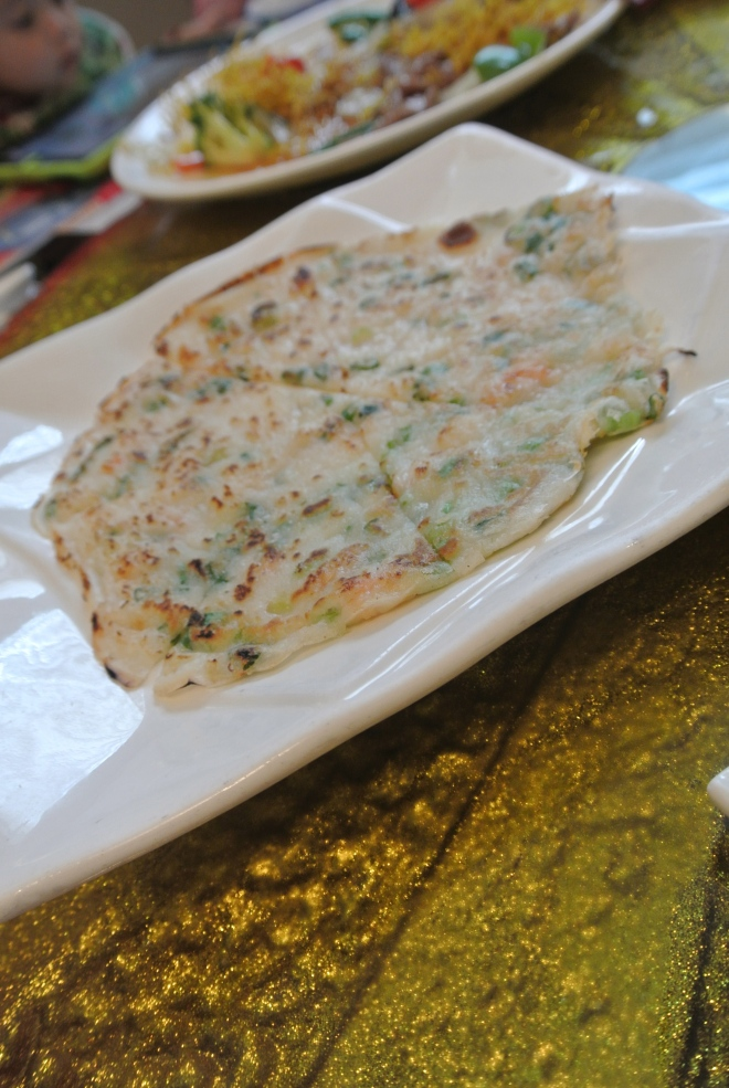 Pan fried seafood pancake with green onion.