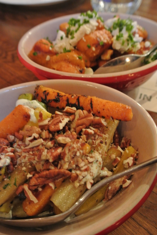 Grilled heirloom carrots with herb dressing and pecans.
