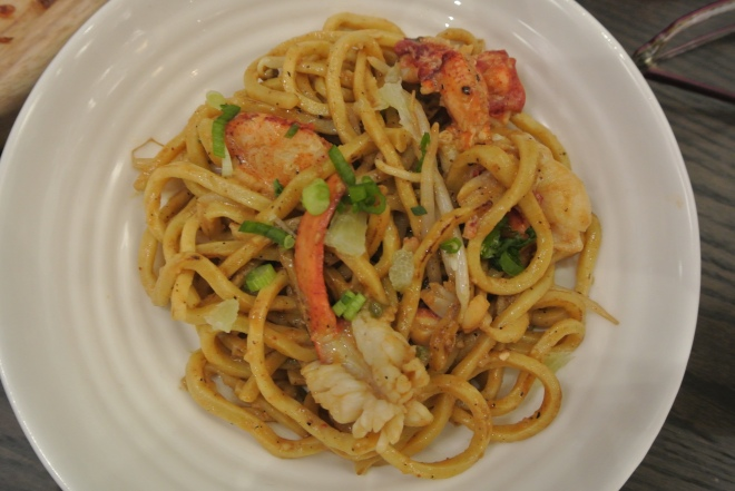 Lobster chow mein with wok fried lobster and chitarra noodles.