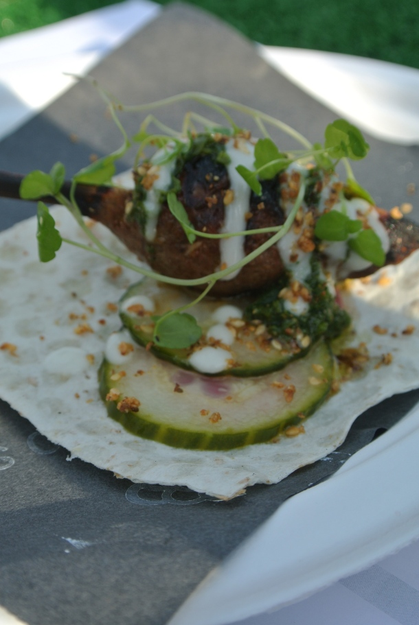 Byblos' charcoal grilled lamb kofte with house pickles, toum and green schug.