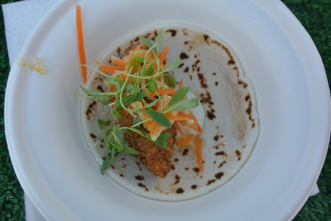 Barque's crispy BBQ pork taco, jicama slaw, tomatillo salsa, lime cream and cilantro leaves.