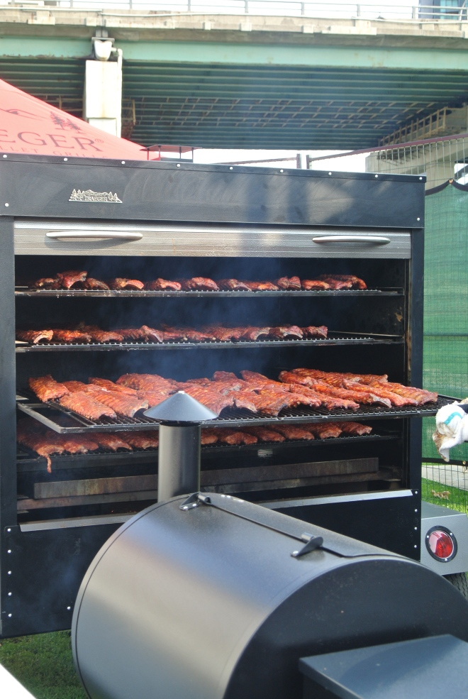 Barque's smoker full of ribs.