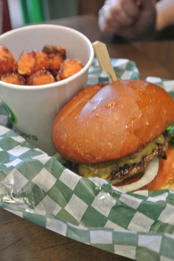 Jenn's chicken sandwich is a seared chicken breast, caramelized onions, lettuce and honey garlic mayo - served here with sweet potato tots.