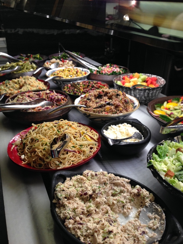 The large salad station with so many different and unique salads.