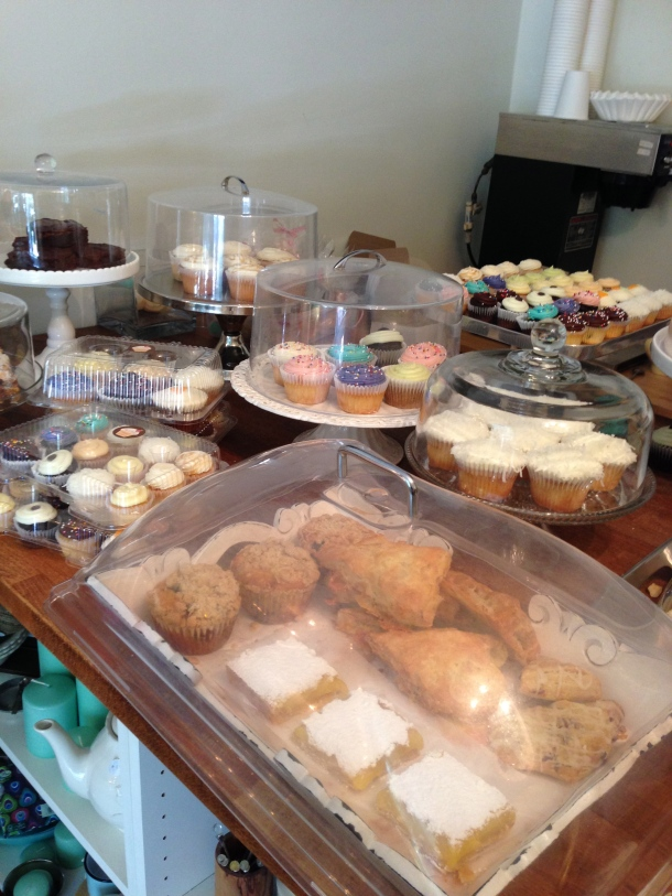 A counter full of delicious baked goods.