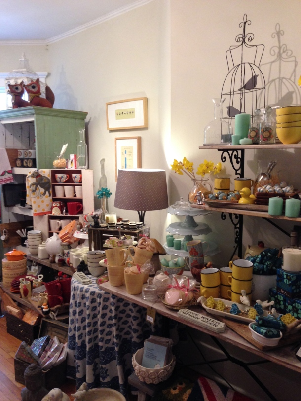 The back room full of beautiful items for the kitchen and home.