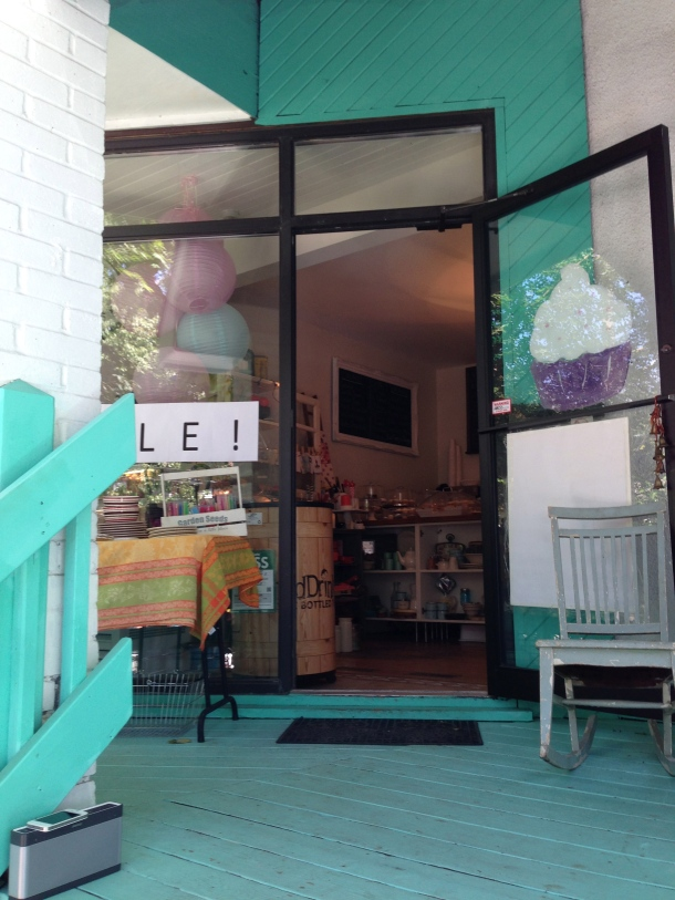 The entrance to the cute Life is Sweet bakery and gift shop.