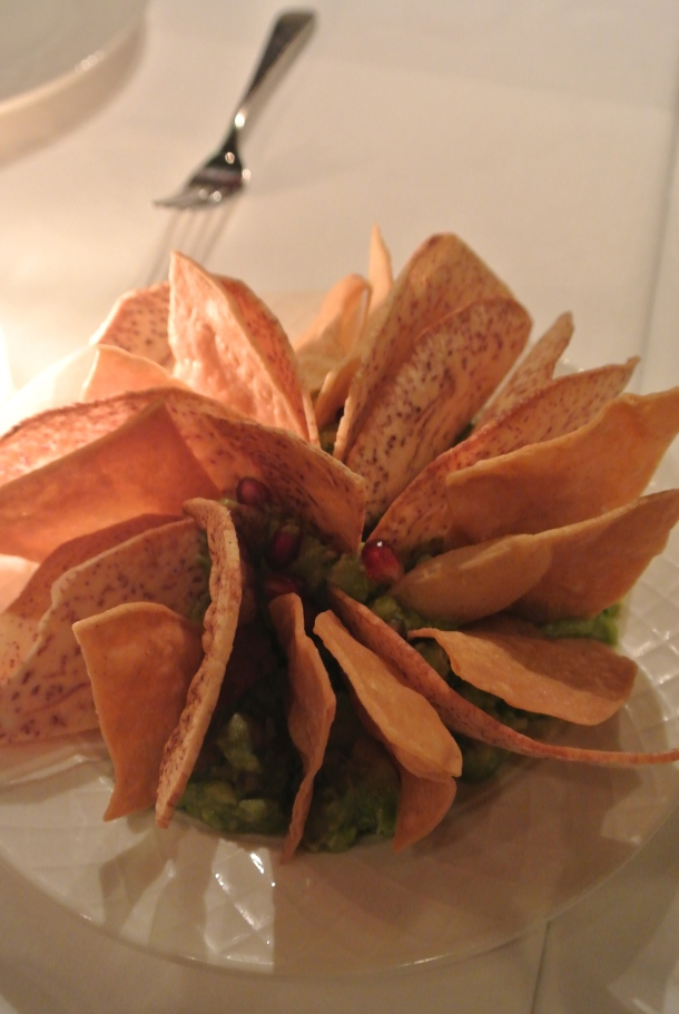 Housemade guacamole, pomegranate and chips.