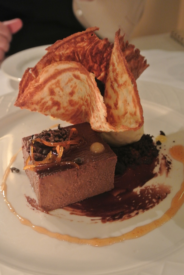 Flan de Chocolate served with burnt milk ice cream, guajillo orange confit and a tuille stuffed with nutella.