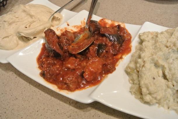 Hummus with Tahini, Baba Ganoush and Eggplant served with pitas to dip.