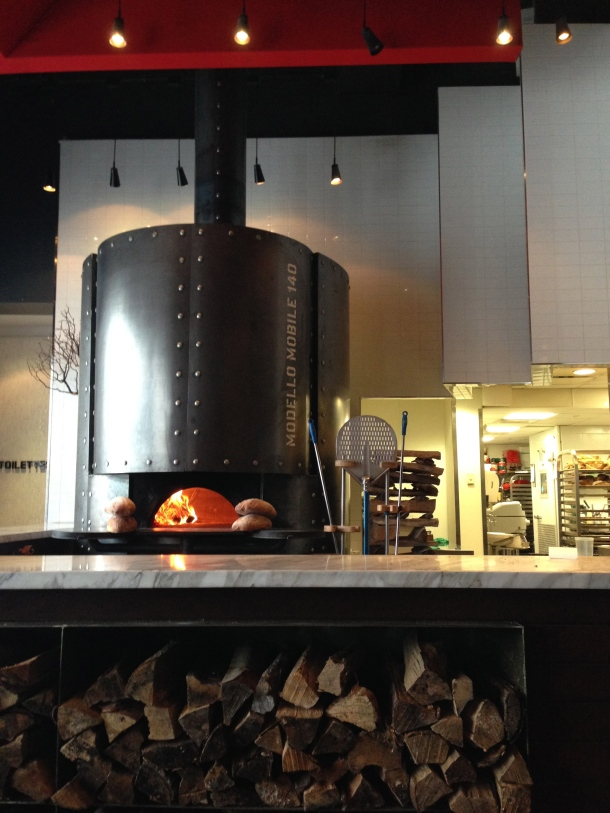 The beautiful brick pizza oven in Fabbrica's open kitchen.